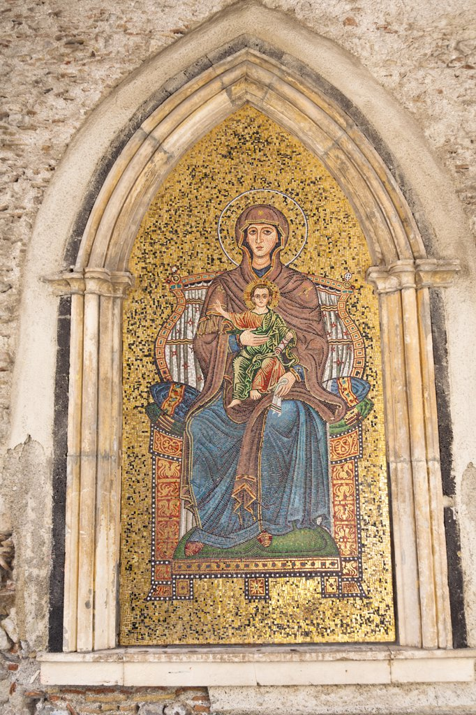 Stock Photo: 4290-1502 Mosaic of Mary and Jesus on wall of Torre dell' Orologio, La Porta Di Mezzo, Piazza IX Aprile, Taormina, Sicily, Italy