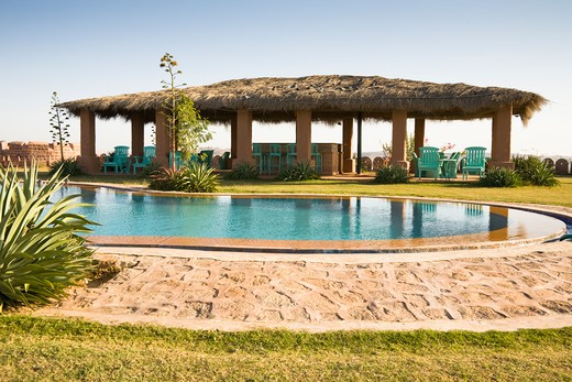 Swimming pool and terrace at Osian Camel Camp, Osian, Rajasthan, India : Stock Photo