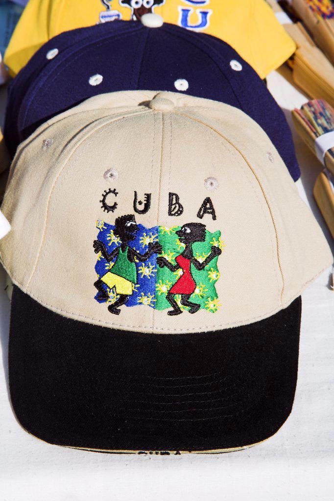 Baseball cap incorporating dancers motif, on a market stall, Craft Market, Guardalavaca, Holguin Province, Cuba : Stock Photo