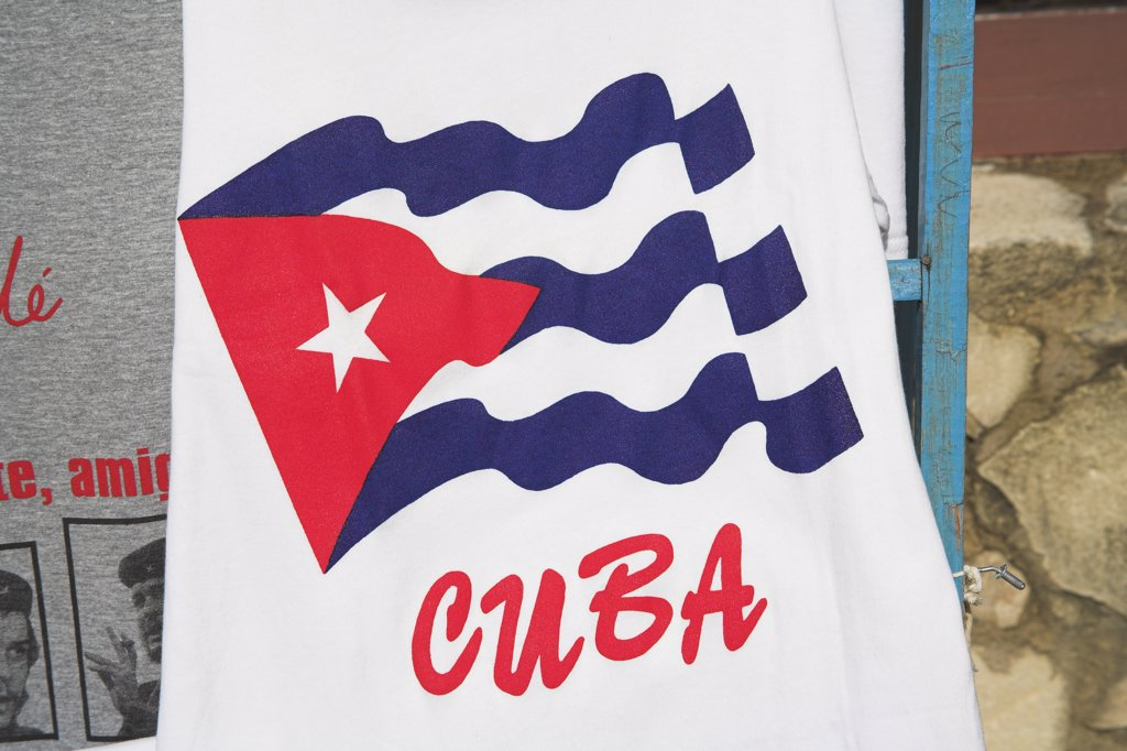 Stock Photo: 4290-2622 Cuban flag printed on a T-shirt in the Craft Market, Guardalavaca, Holguin Province, Cuba