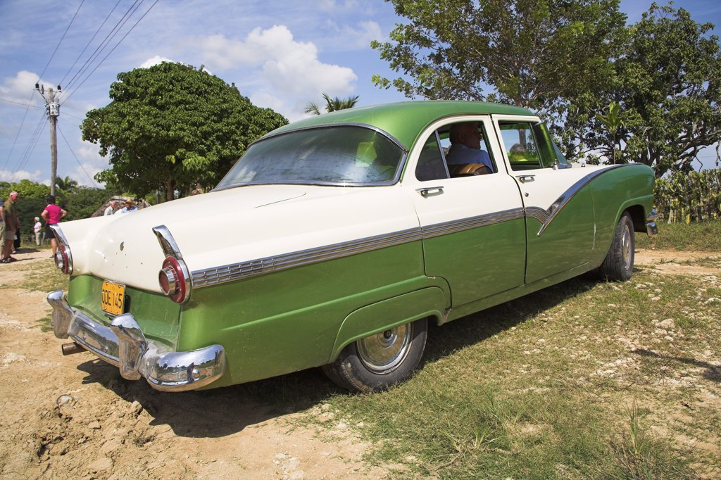 Classic American green car, near Santiago de Cuba, Cuba : Stock Photo