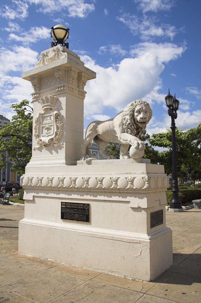 Stock Photo: 4290-2877 Lion statue, Parque Jose Marti, Plaza de Armas, Cienfuegos, Cienfuegos Province, Cuba