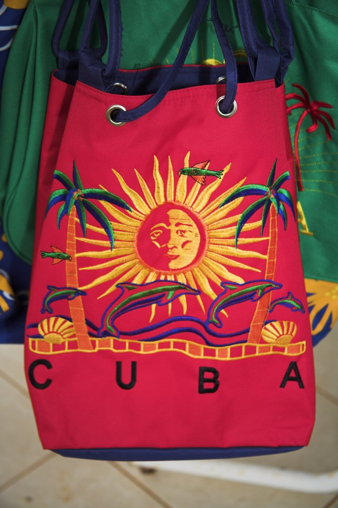 Stock Photo: 4290-2899 Brightly coloured Cuba shopping bag on display outside a shop, Havana, Habana Vieja, Cuba