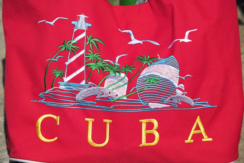 Stock Photo: 4290-2941 Brightly coloured red Cuba shopping bag on display outside a shop, Havana, La Habana Vieja, Cuba