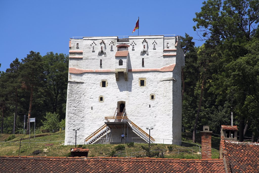 Stock Photo: 4290-3092 A white watchtower on hillside, overlooking town square, Brasov, Transylvania, Romania