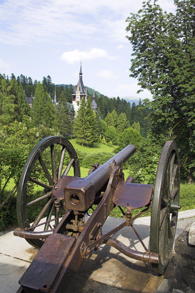 Peles Castle, cannon in foreground, Sinaia, Prahova Valley, Transylvania, Romania : Stock Photo