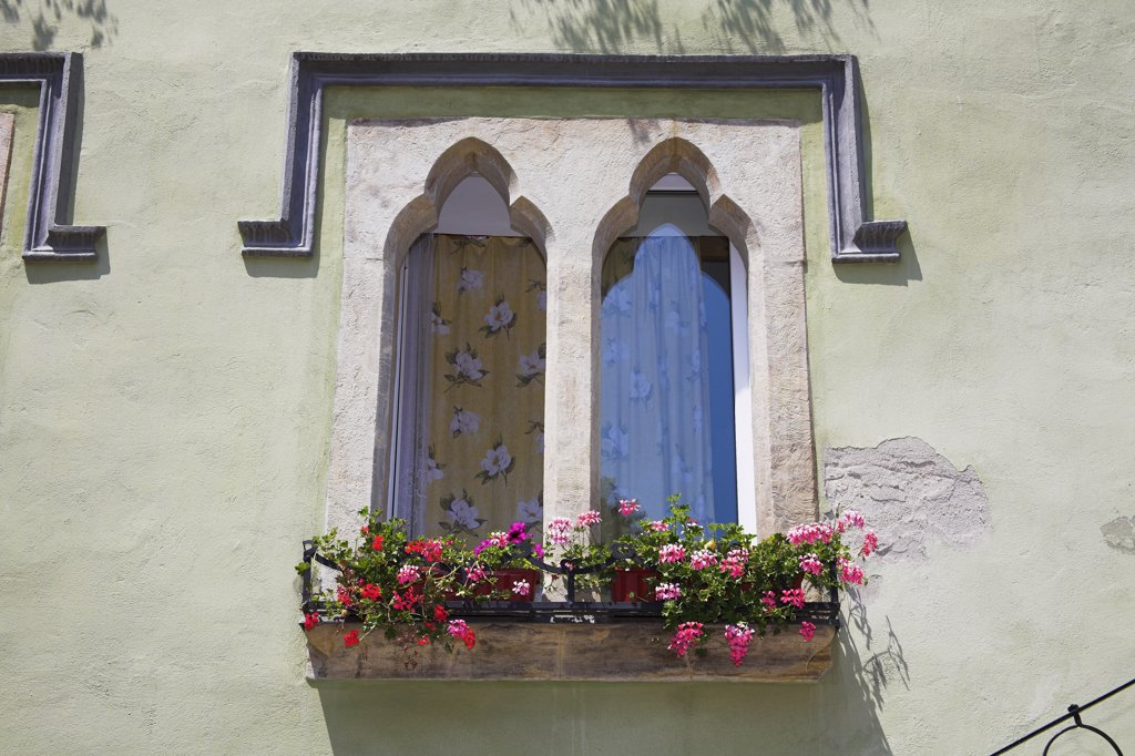 Stock Photo: 4290-3170 Old gothic style window on building in the old town, Sighisoara, Transylvania, Romania