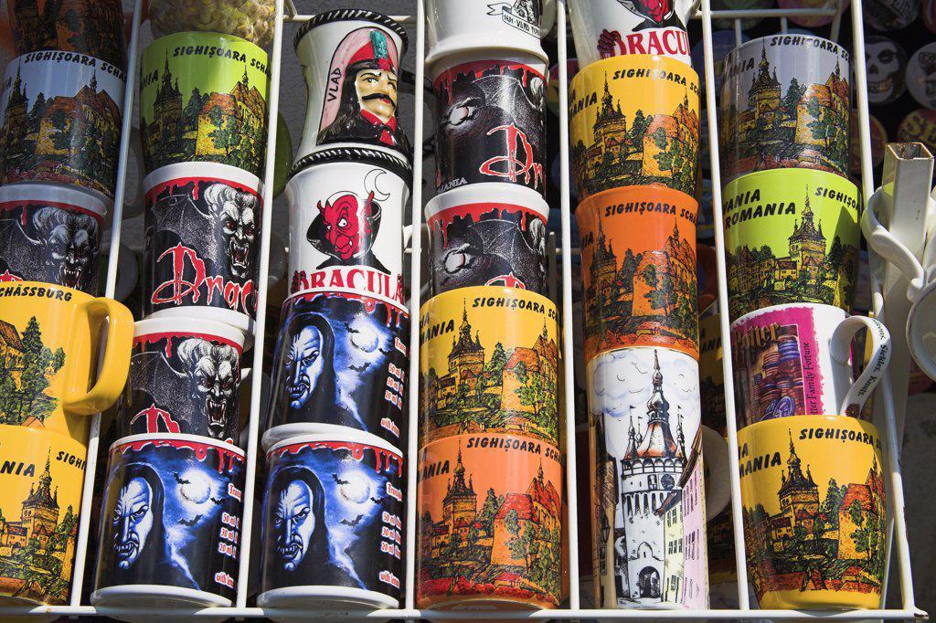 Colourful pottery coffee mugs for sale outside gift shop, Sighisoara, Transylvania, Romania : Stock Photo