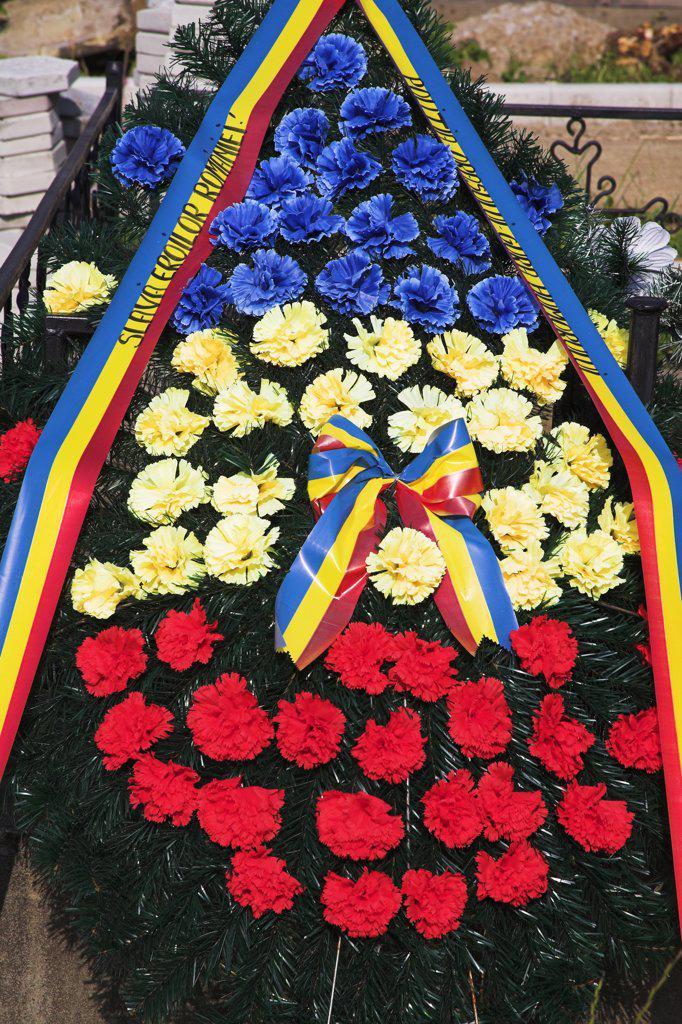 Wreath of carnations in cemetery, Voronet Monastery, near Gura Humorului, Bucovina, Moldavia, Romania : Stock Photo