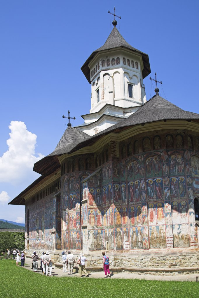 Stock Photo: 4290-3345 Tourists, Church Of The Annunciation, Moldovita Monastery, Moldovita, Southern Bucovina, Moldavia, Romania