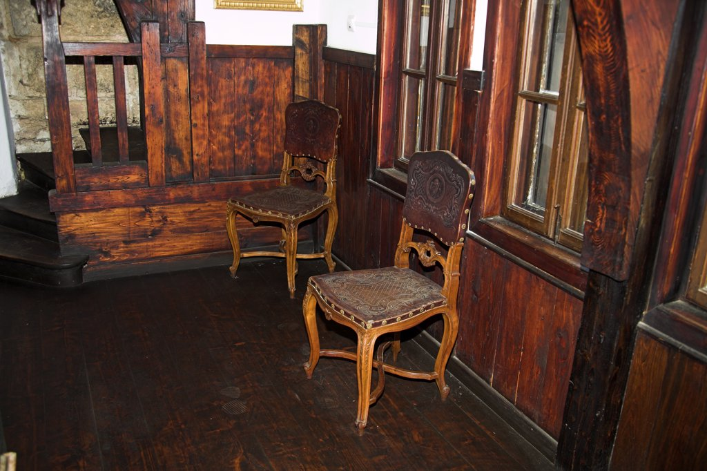 Stock Photo: 4290-3525 Antique wooden chairs in room, Bran Castle, Bran, near Brasov, Transylvania, Romania