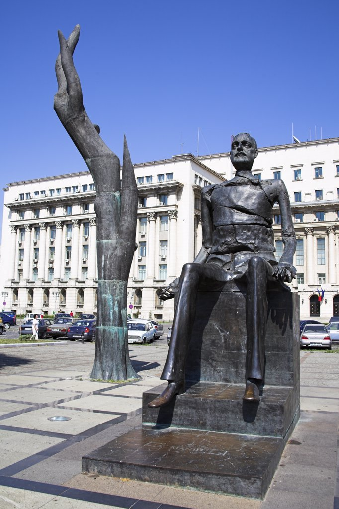 Stock Photo: 4290-3744 Statue of Iuliu Maniu and broken man sculpture, Piata Revolutiei, Revolution Square, Bucharest, Romania