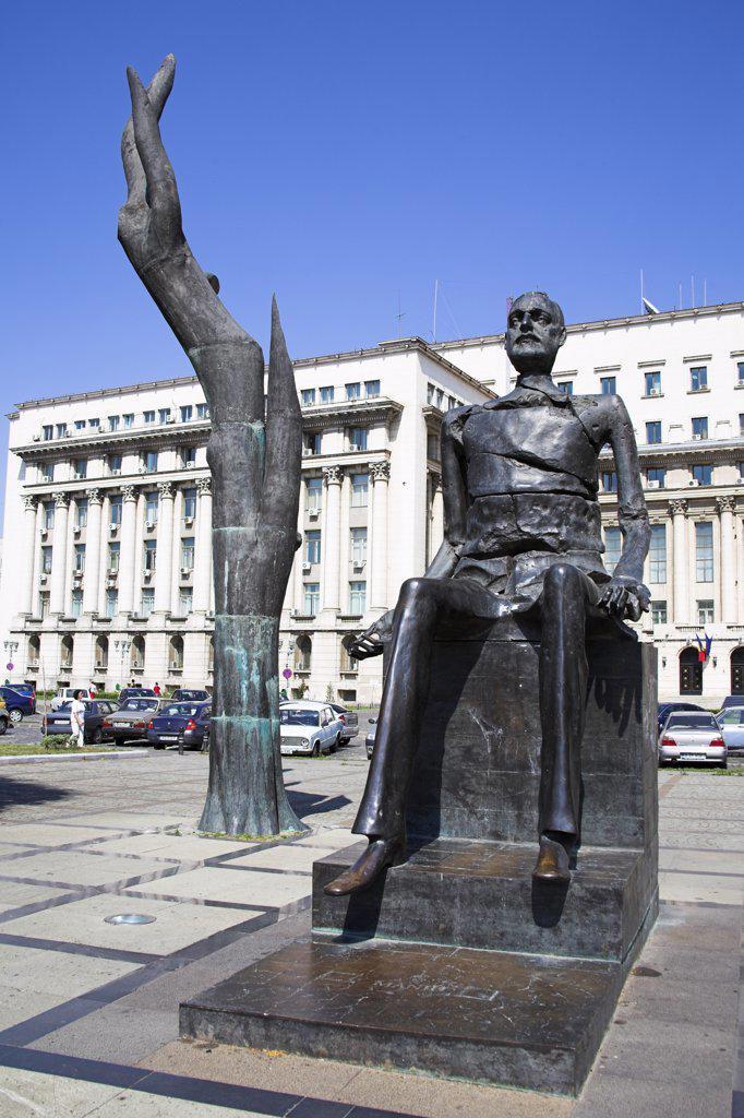 Statue of Iuliu Maniu and broken man sculpture, Piata Revolutiei, Revolution Square, Bucharest, Romania : Stock Photo