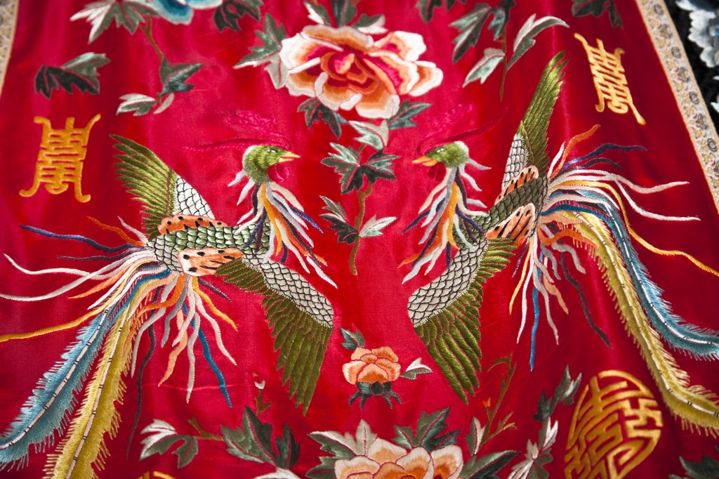 Stock Photo: 4290-4207 Colourful red and green Chinese embroidered silk garment for sale, China