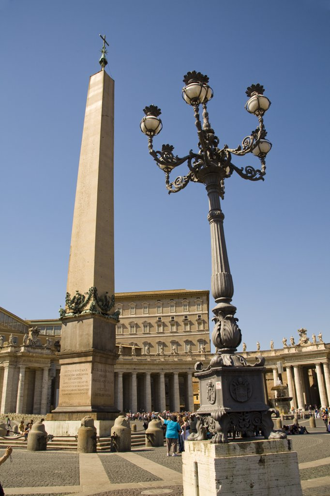 Stock Photo: 4290-4751 Obelisk, streetlamp and tourists in Saint Peter's Square, Piazza San Pietro, Vatican City, Rome, Italy