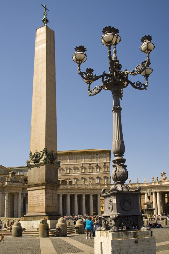 Stock Photo: 4290-4752 Obelisk, streetlamp and tourists in Saint Peter's Square, Piazza San Pietro, Vatican City, Rome, Italy
