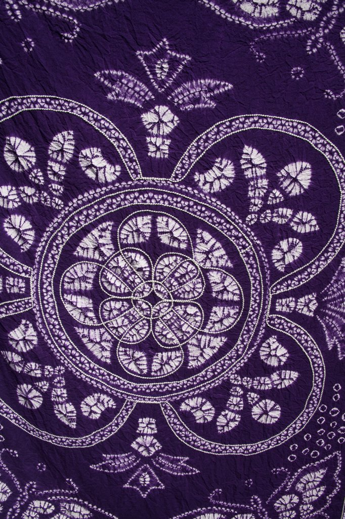 Stock Photo: 4290-4817 Colourful mauve and white tie dyed tablecloth, Baisha, Yunnan Province, China