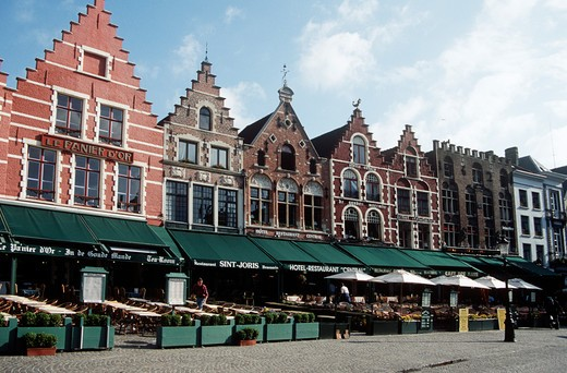 Early morning, restaurants and buildings in the Markt, Market Place, Bruges, Belgium : Stock Photo