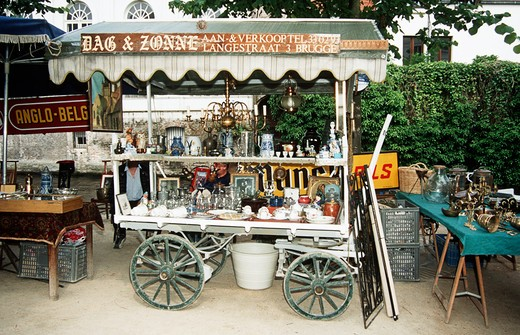Antiques for sale on a cart on a pavement in a flea market, Bruges, Belgium : Stock Photo
