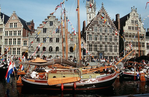 Several old yachts on the River Leie, moored at the quayside, at Graslei Street, Ghent, Belgium : Stock Photo