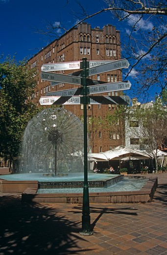 El Alamein Fountain and city and country distance sign, near Kings Cross, Sydney, New South Wales, Australia : Stock Photo