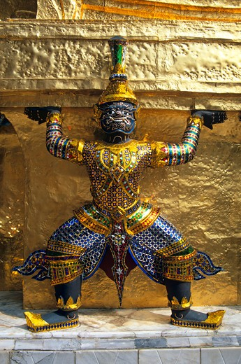 Stock Photo: 4290-5256 Guardian mythical demon supporting golden chedi, Grand Palace, Bangkok, Thailand
