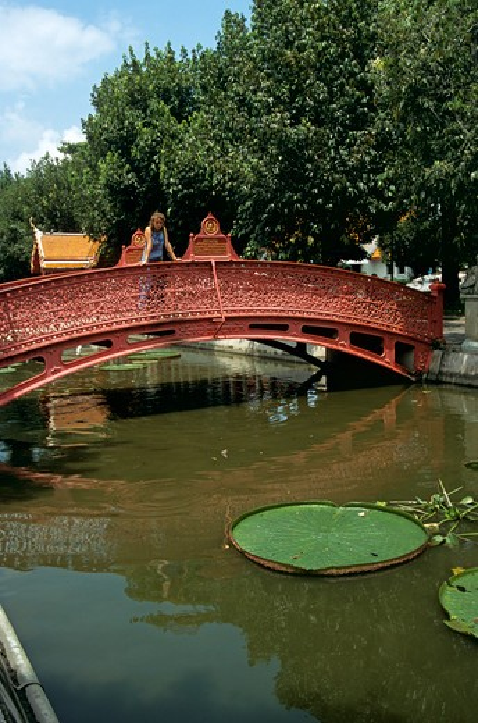 Stock Photo: 4290-5504 Woman on bridge, Marble Temple, Wat Benchamabophit, Bangkok, Thailand