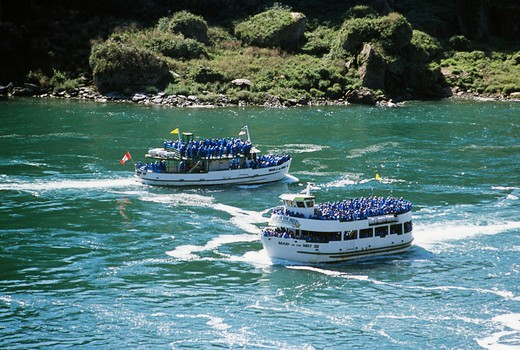 Stock Photo: 4290-5534 Maid of the Mist boats and tourists passing on Niagara River approaching Niagara Falls, Ontario, Canada