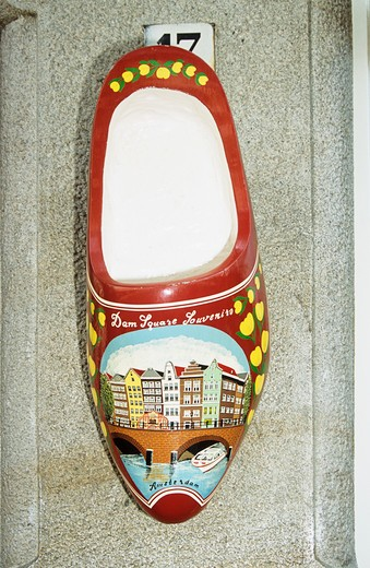 Stock Photo: 4290-6093 Large wooden souvenir clog hanging outside a house, Amsterdam, Holland