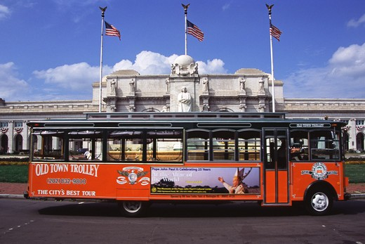 Stock Photo: 4290-6234 Old Town Trolley Bus driving past Union Railway Station, Washington, DC, USA