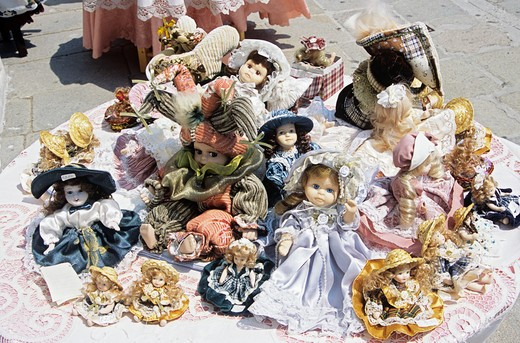 Stock Photo: 4290-6357 Several colourful dolls for sale on display outside shop, Burano, Venice, Italy