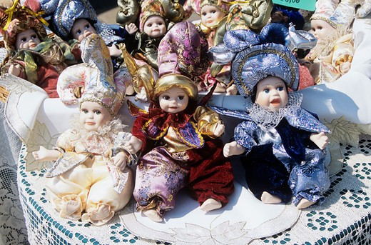 Several colourful dolls for sale on display outside shop, Burano, Venice, Italy : Stock Photo