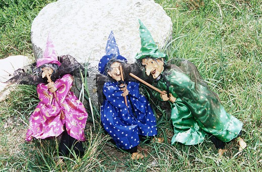 Three colourful witches for sale on display in the grass, Torcello, Venice, Italy : Stock Photo