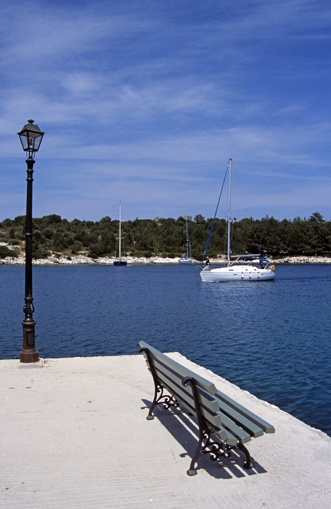 Stock Photo: 4290-6985 Yacht entering harbour, Fiskardo, Kefalonia, Greece