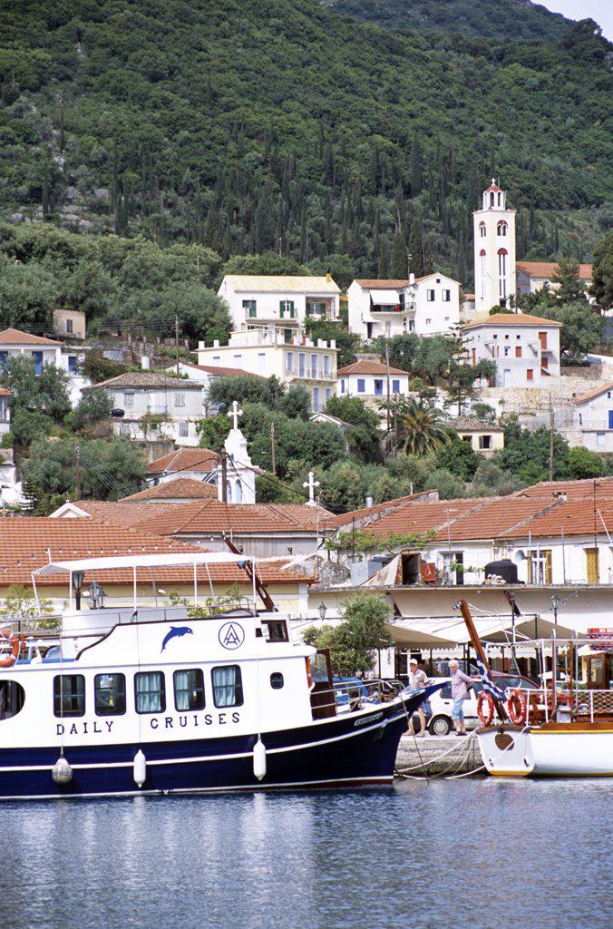 Cruise boat and Vathi town behind, Vathi, Ithaca, Greece : Stock Photo