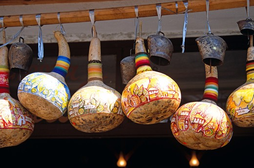 Stock Photo: 4290-7262 Colourful gourds and cattle bells hanging outside shop, Melnik, Bulgaria
