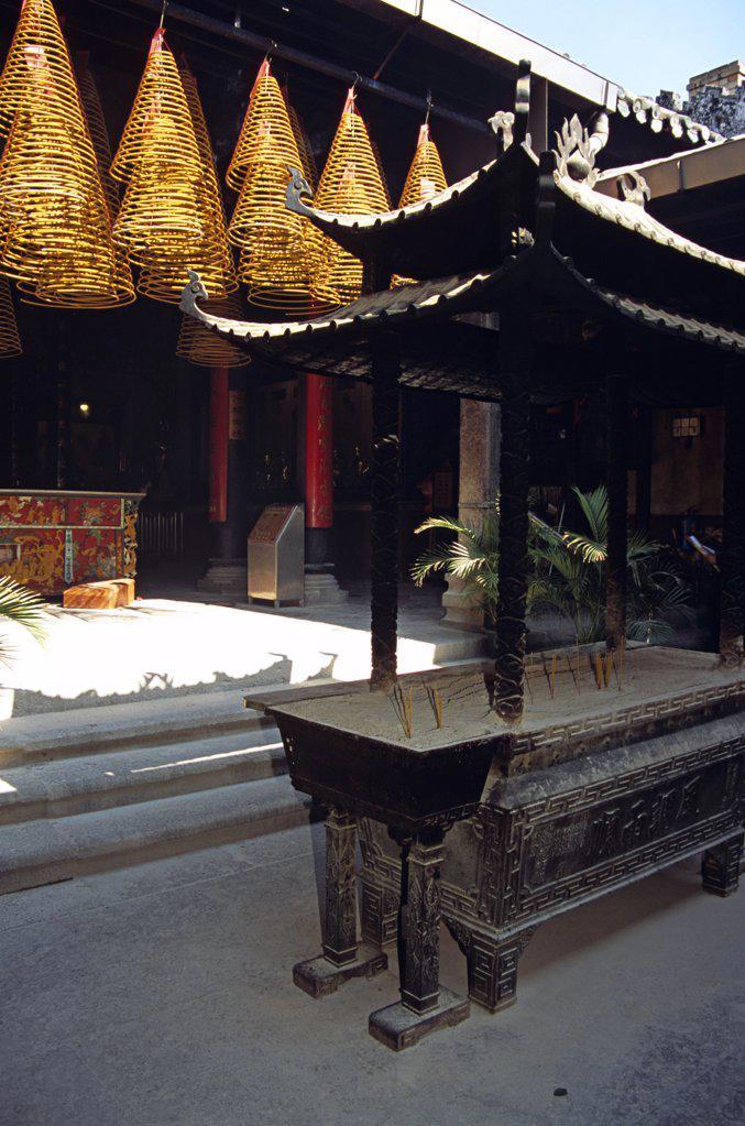Stock Photo: 4290-7958 Shrine and burning incense coils, Kun Iam Temple, Macau, China