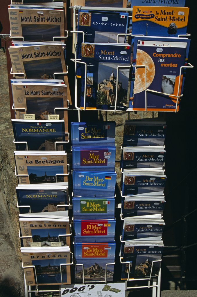 Stock Photo: 4290-7996 Display of books outside gift shop, Le Mont Saint Michel, Normandy, France