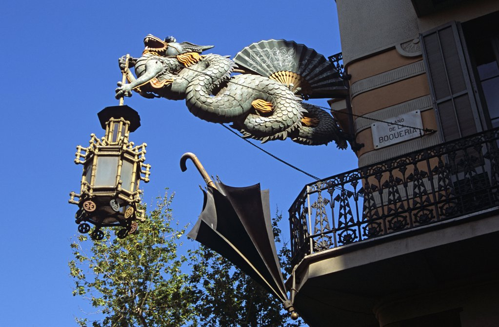 Stock Photo: 4290-8044 Dragon lamp, umbrella and balcony, Casa Bruno Quadras, La Rambla, Barcelona, Spain