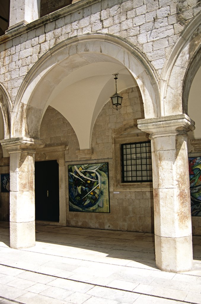 Stock Photo: 4290-8107 Inside courtyard of Sponza Palace, Luza Square, Stradun, Dubrovnik, Dalmatian Coast, Croatia, Former Yugoslavia. Arch and painting in the atrium.