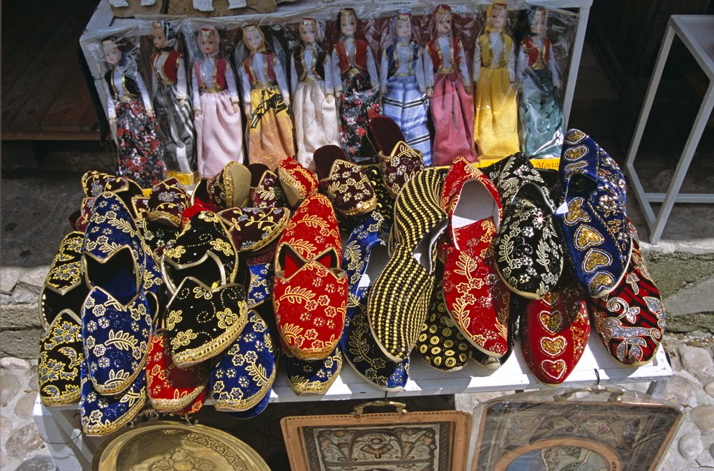 Stock Photo: 4290-8192 Colourful carpet slipper and doll display outside gift shop, Mostar, Bosnia Herzegovina, Former Yugoslavia