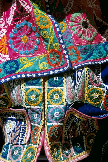 Colourful patterned jacket for sale outside clothing shop, Cusco, Peru : Stock Photo