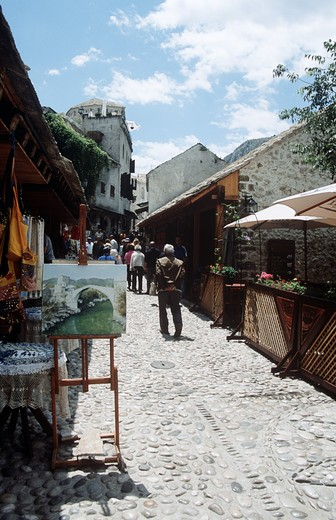 Stock Photo: 4290-9047 People walking along cobbled street, Mostar, Bosnia Herzegovina, Former Yugoslavia
