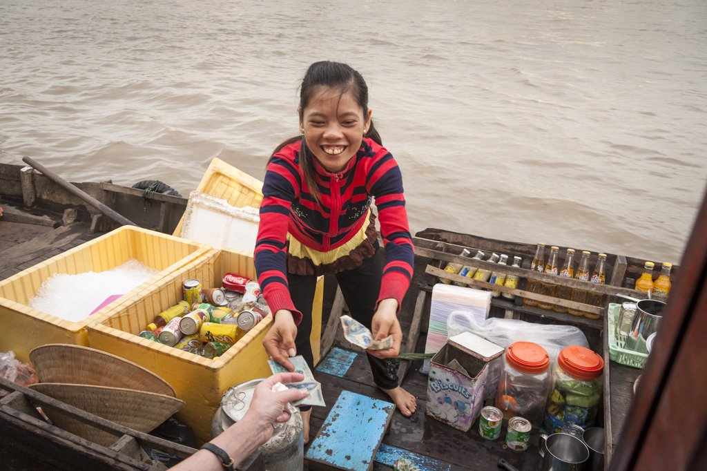 Stock Photo: 4290-9249 Vietnam, Mekong River Delta, Cai Rang, near Can Tho, young girl selling drinks from boat in floating market