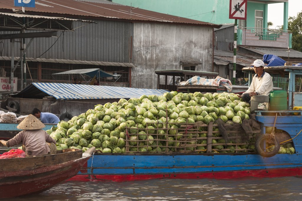 Stock Photo: 4290-9255 Vietnam, Mekong River Delta, Cai Rang, near Can Tho, man selling vegetables from boat in floating market