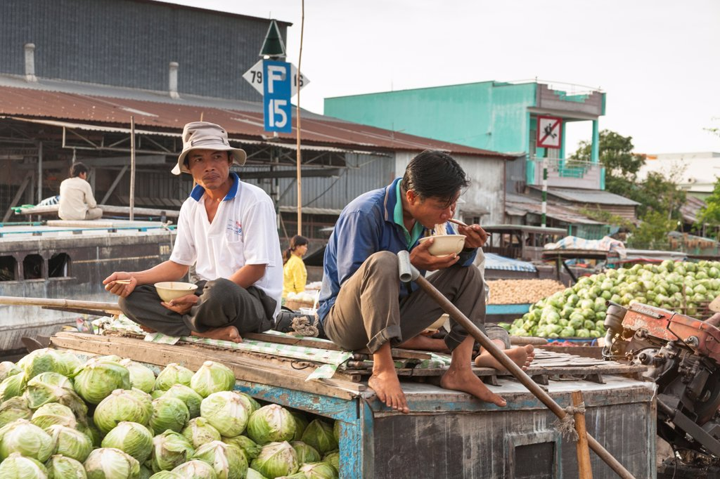 Stock Photo: 4290-9256 Vietnam, Mekong River Delta, Cai Rang, near Can Tho, men selling vegetables from boat in floating market