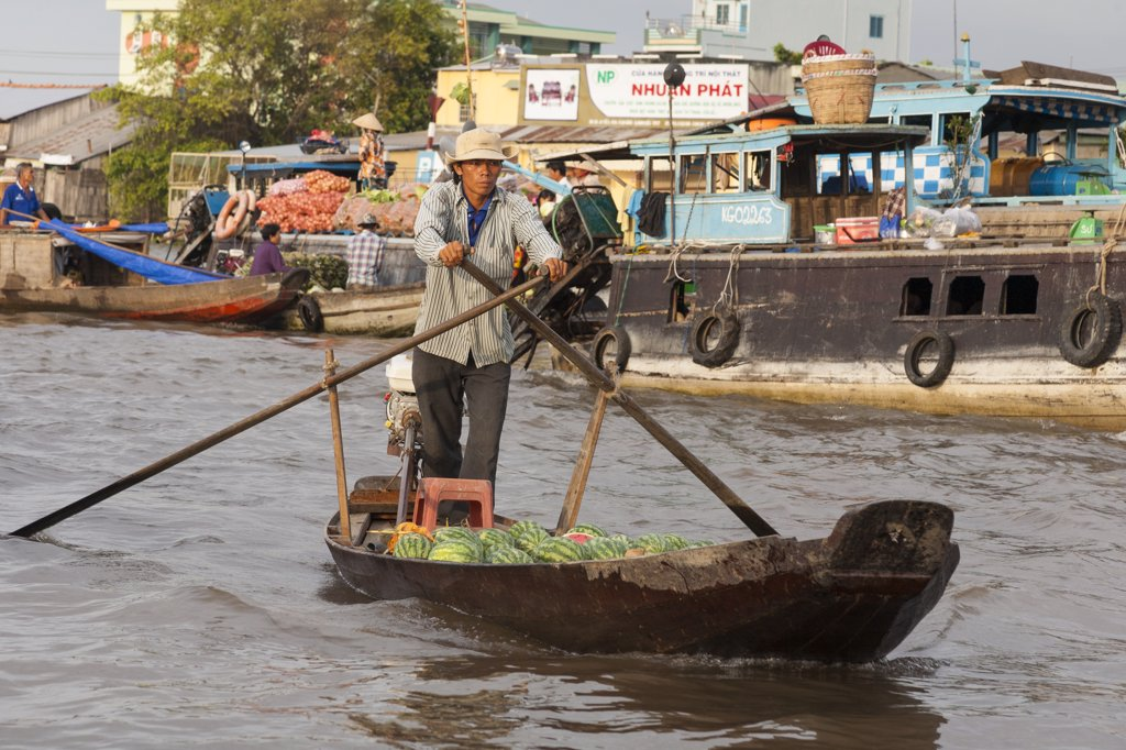 Stock Photo: 4290-9257 Vietnam, Mekong River Delta, Cai Rang, near Can Tho, man rowing his boat in floating market