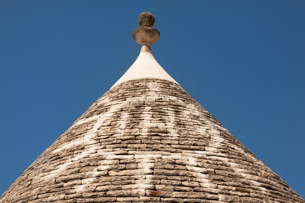Stock Photo: 4290-9488 Conical dry stone roof of trulli house, with painted sun symbol, Alberobello, Bari province, Puglia region, Italy