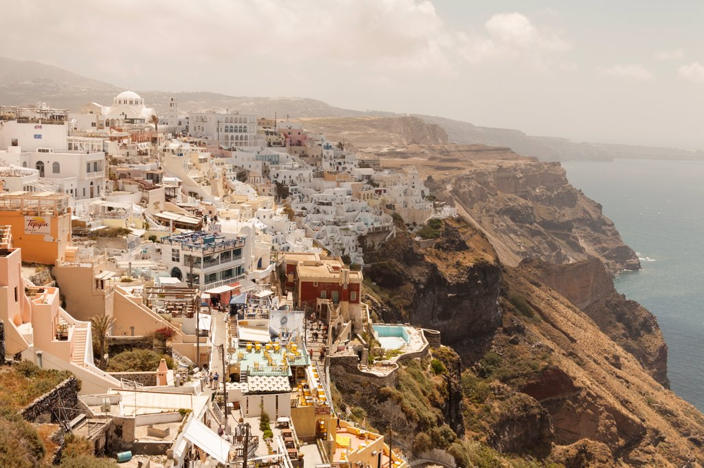 Stock Photo: 4290-9520 Overlooking the clifftop town of Fira, the capital town of the Greek island of Santorini, Greece