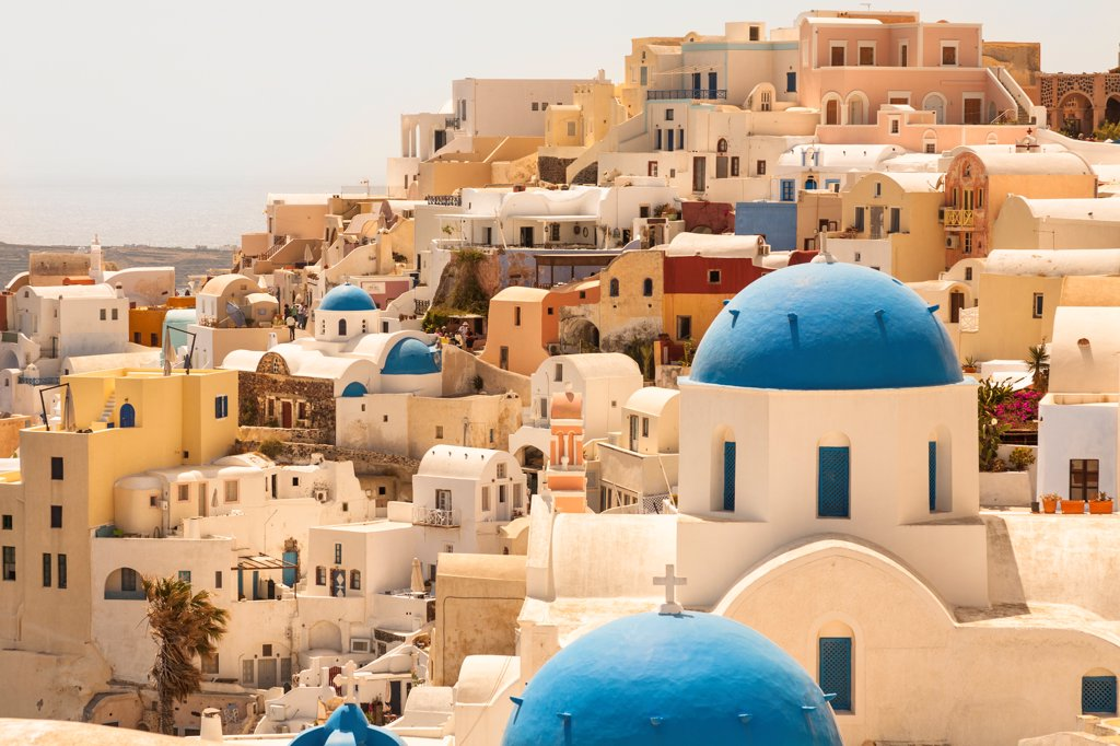 Stock Photo: 4290-9536 Anastasi Church in foreground, in the town of Oia, Santorini, Greece